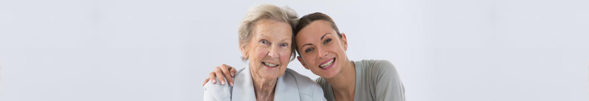 female caregiver with senior woman smiling