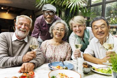 group of seniors enjoying their meal
