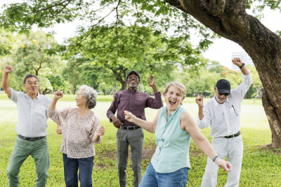group of seniors expressing happy gesture